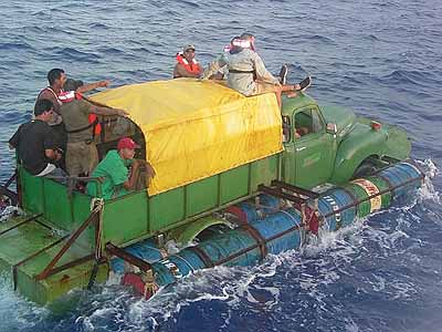 (ASSOCIATED PRESS/U.S. COAST GUARD / July 16, 2003)  Twelve Cuban migrants attempt to cross the Florida Straights in a boat fashioned out of a 1951 Chevy pickup truck driving it within 40 miles of the United States before they were found by the U.S. Coas
