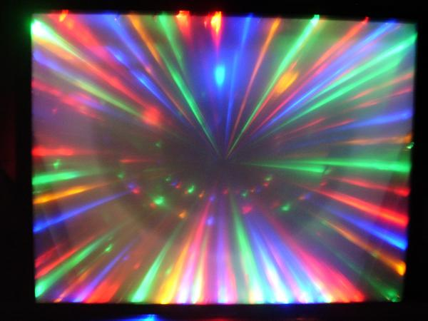 "what you get when you combine a dead 65"" projection tv with some lenses a few hundred lights, a couple servos, and some custom mirrors shame you cant see em twist an dance."